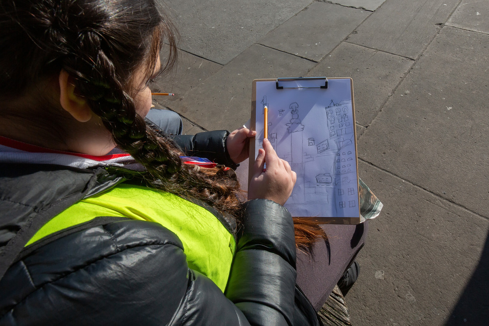 A young artist from Nelson School in London sketching in Trafalgar Square