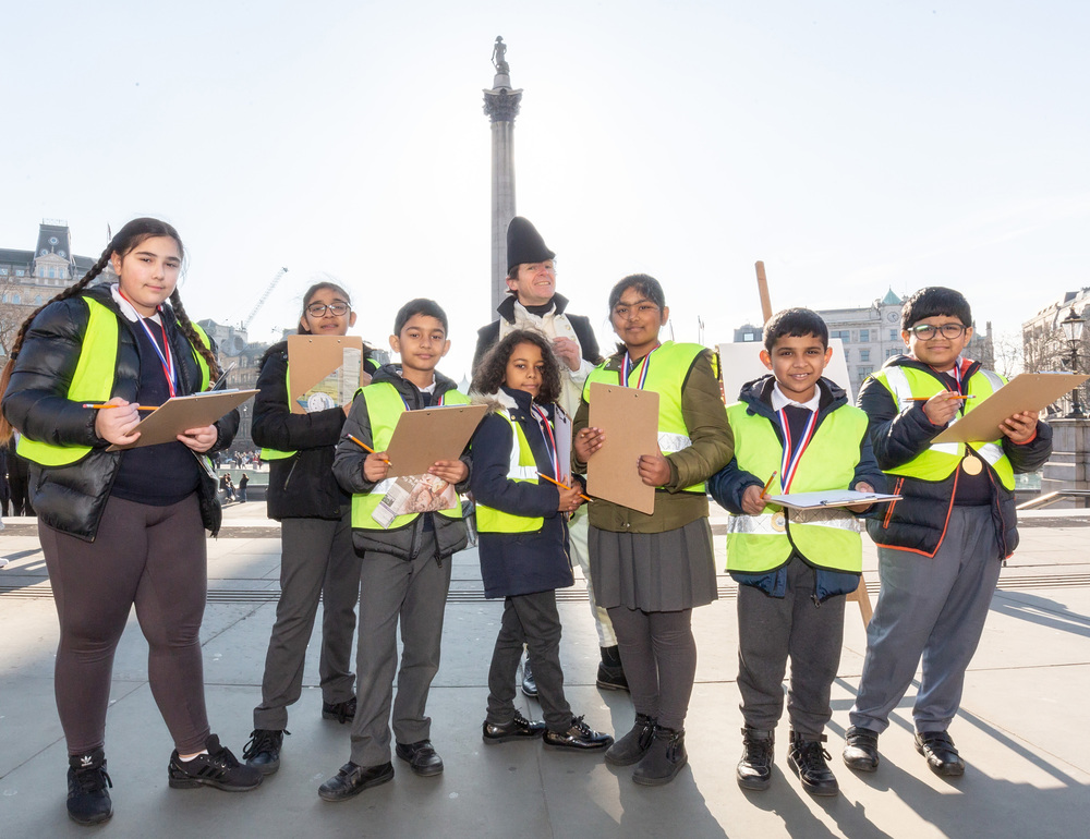 Pupils from Nelson School in Newham sketching in Trafalgar Square