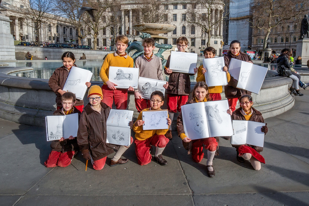 Hill House School pupils show off their artwork in Trafalgar Square
